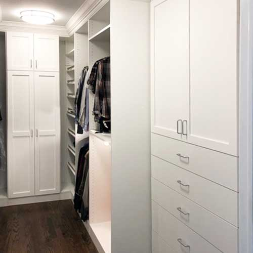 walk-in closet with built-in drawers