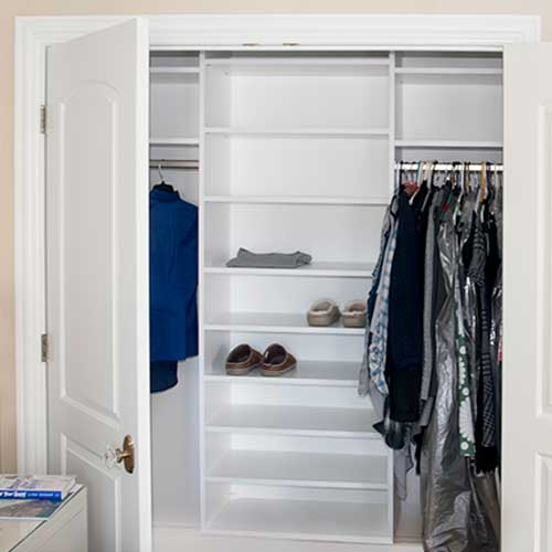 simple reach in closet with hanging and shelving
