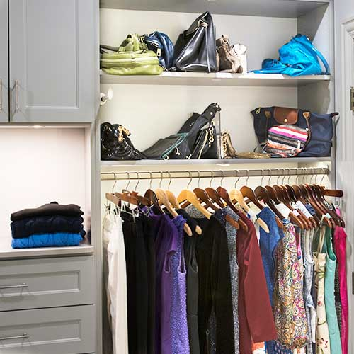 lady's custom closet organizers with hanging and purse organization
