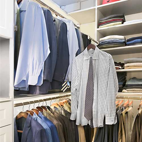 men's custom closet with shelving, closet organizers and valet pole closet accessory